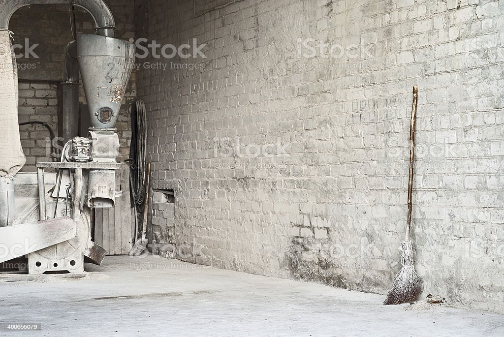 electric corn mill,  wooden broom stock photo