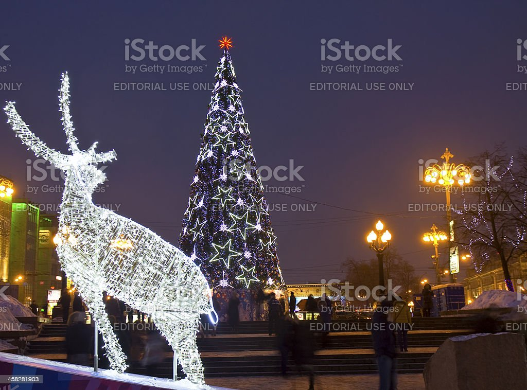 Electric deer and Christmas tree royalty-free stock photo