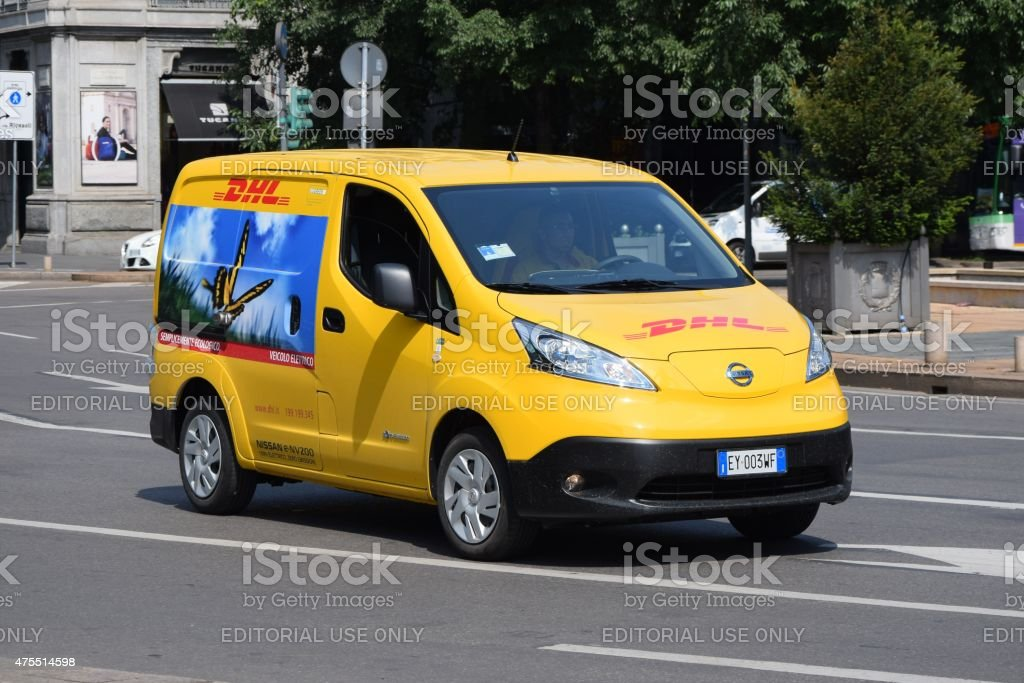 Electric DHL van in motion stock photo