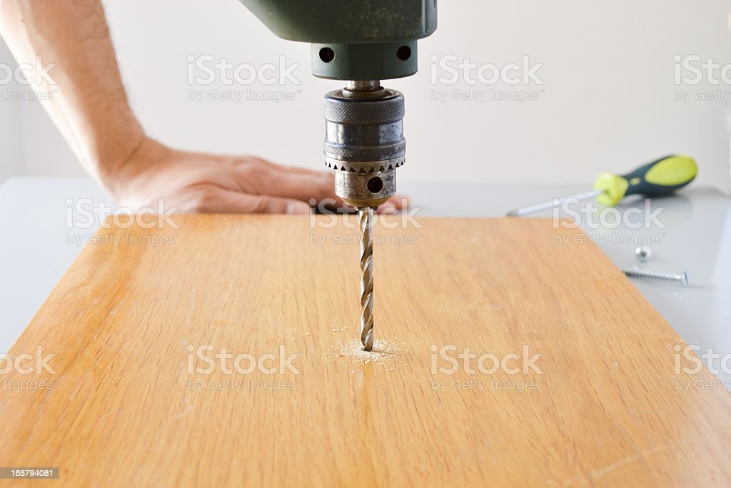 Electric drill drilling a hole royalty-free stock photo