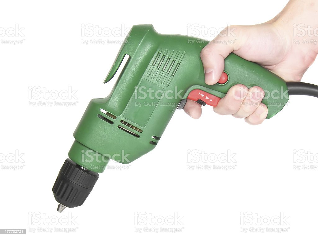 Electric drill in a hand isolated on white. stock photo