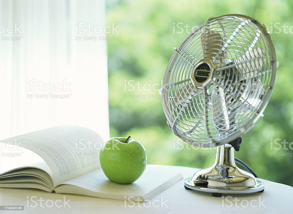 electric fan and apple stock photo