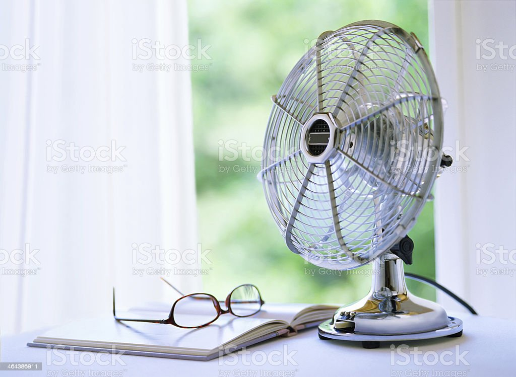 electric fan and book stock photo