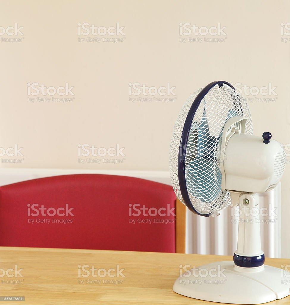 electric fan in  empty office stock photo