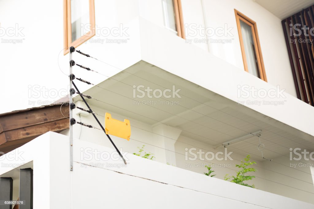 Electric fence protect residential house stock photo