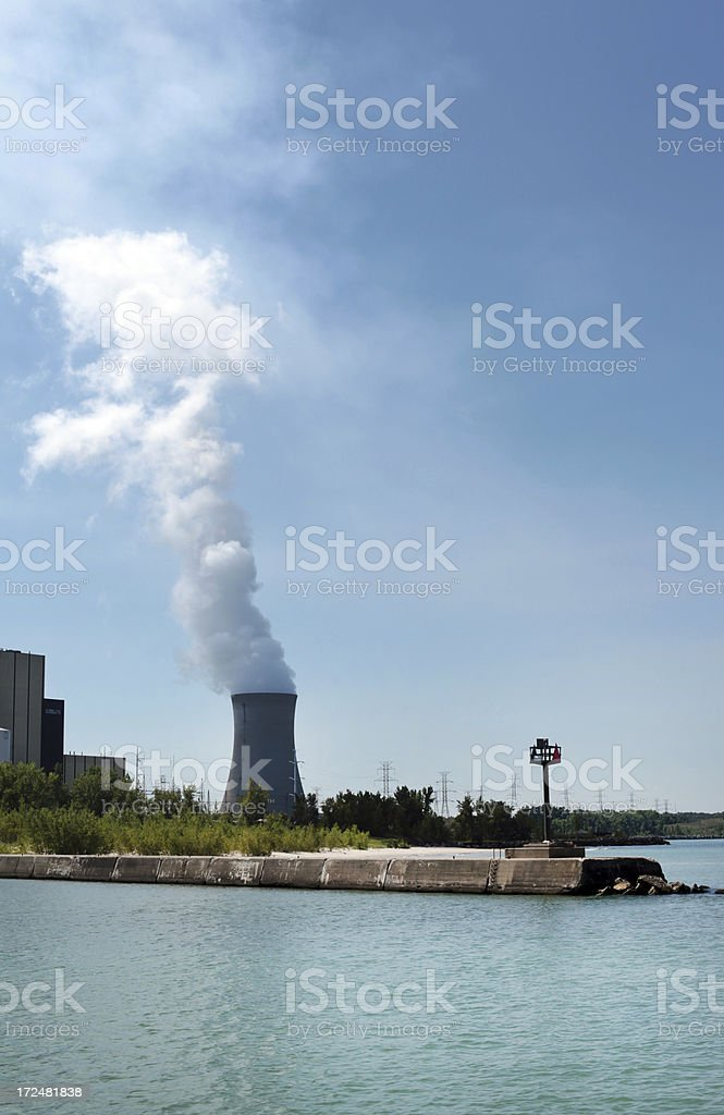 Electric generating plant with steam clouds.  Vertical.  Copy space/ royalty-free stock photo