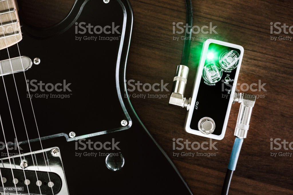 Electric Guitar and Effects Pedal stock photo