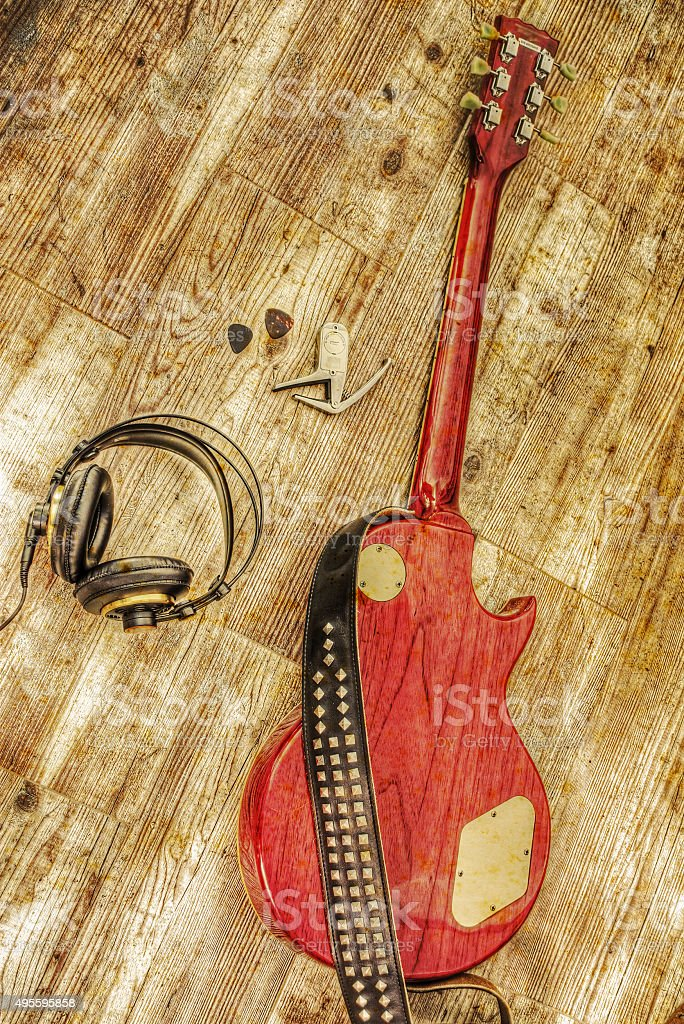 electric guitar and headphones in vintage tone stock photo