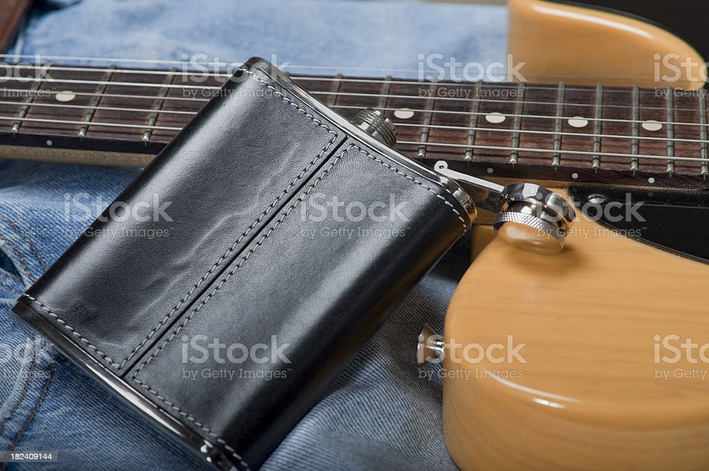 Electric Guitar and Open Flask royalty-free stock photo