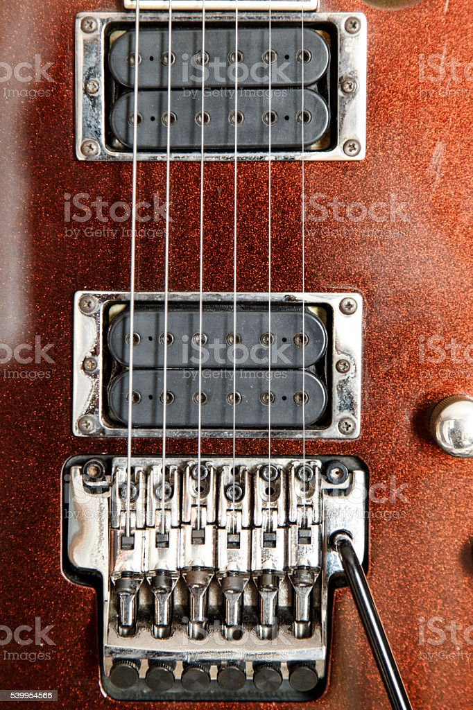 Electric guitar detail view, zoom in to floyd rose stock photo