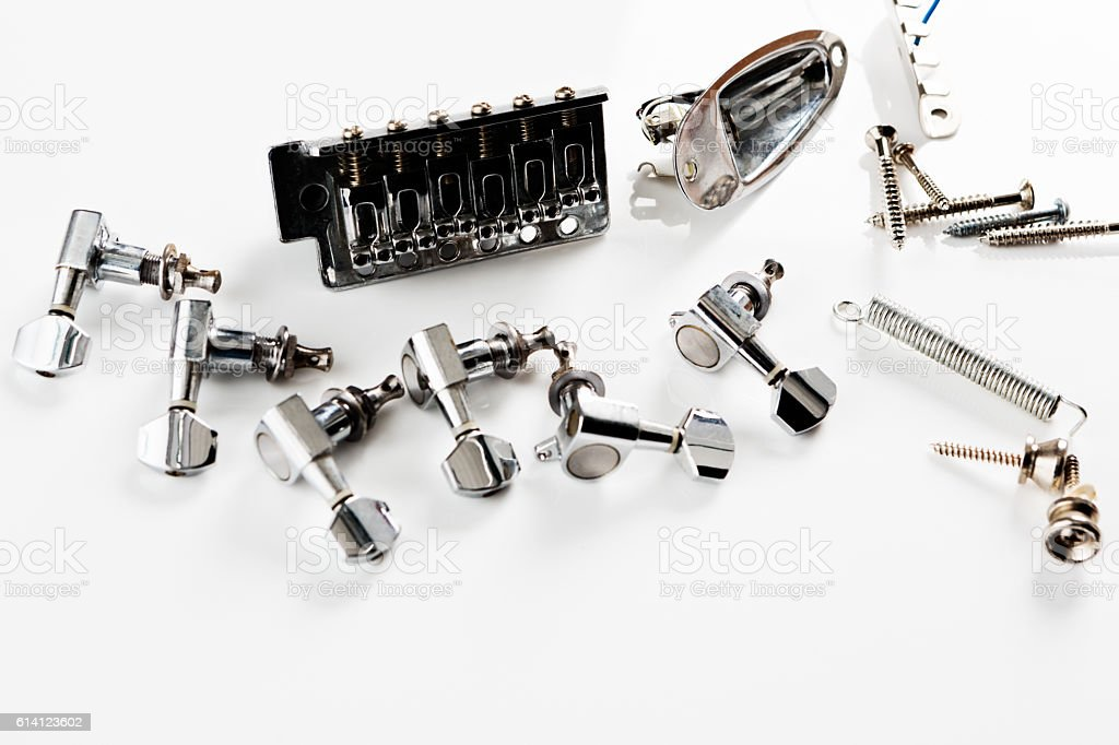 Electric guitar parts, including tuners, on white stock photo
