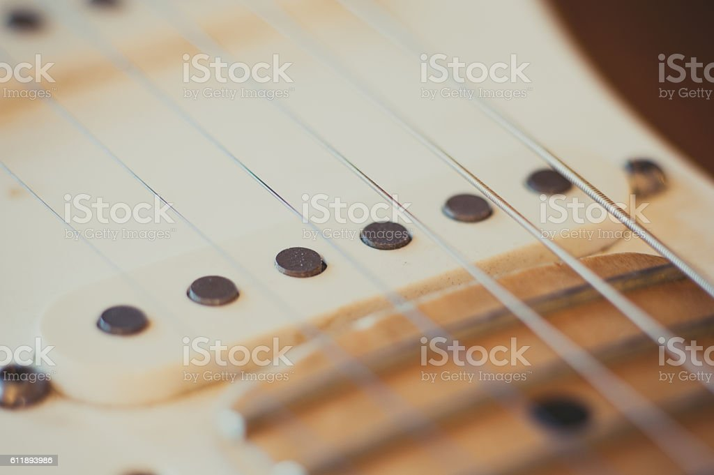Electric guitar pick up detail, music symbol stock photo