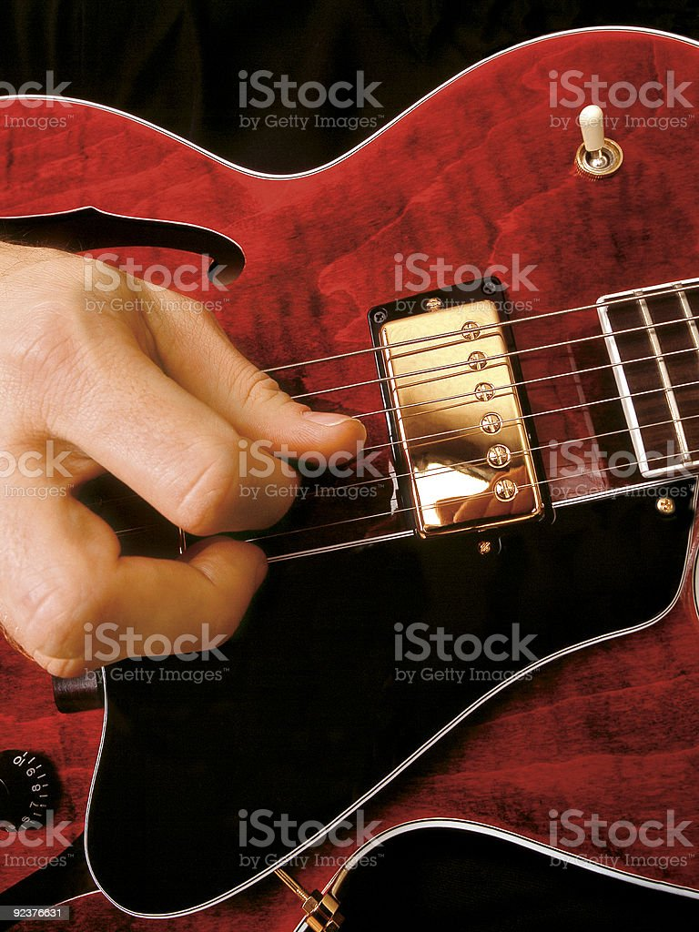 Electric guitar playing royalty-free stock photo