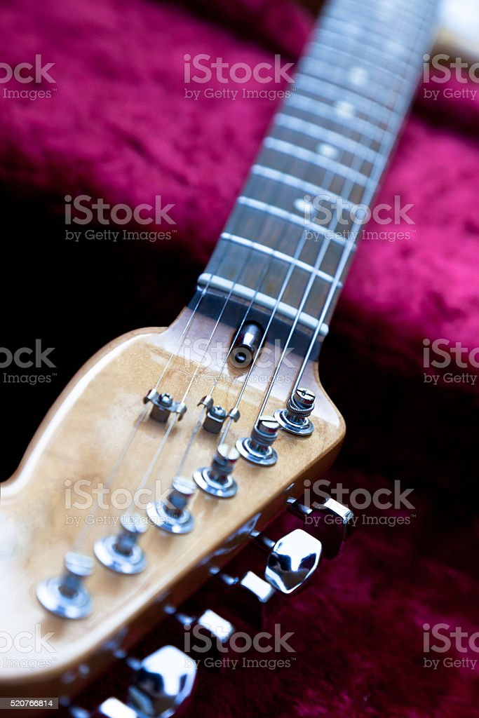 Electric Guitar Resting on Red Velvet in Case stock photo