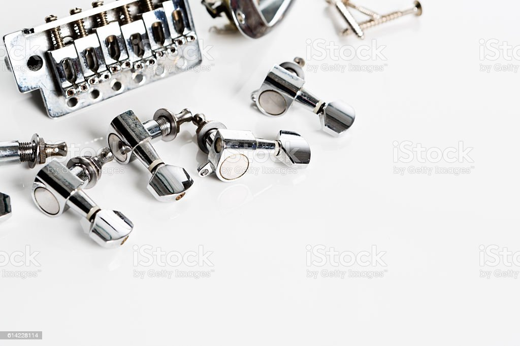 Electric guitar tuners, bridge and fasteners on white stock photo