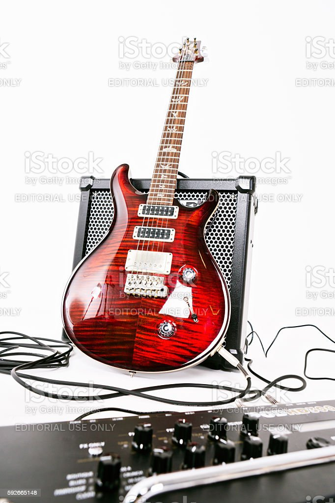 PRS electric guitar with Roland amp and multi-effects unit stock photo