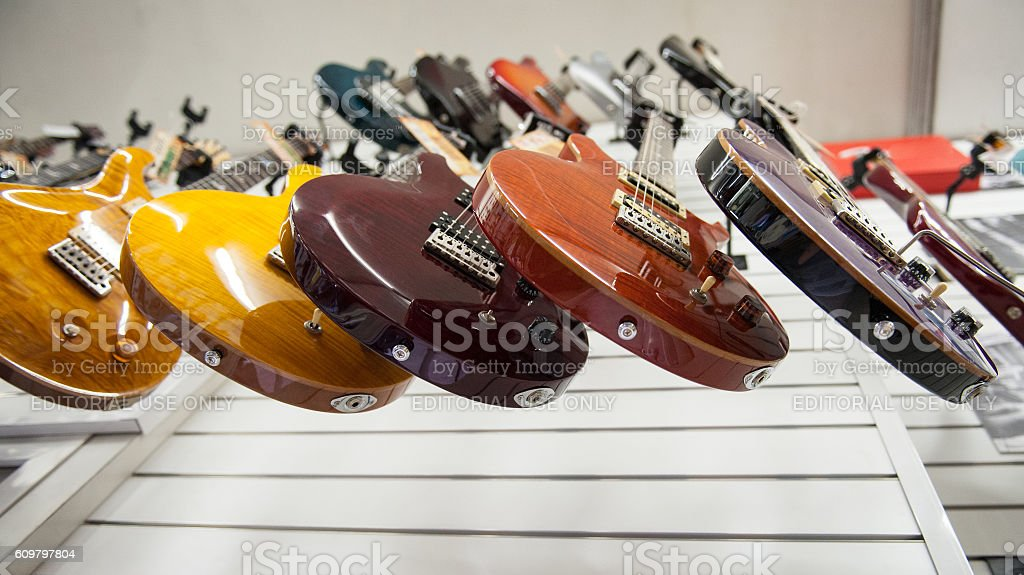 Electric guitars hanging in store stock photo