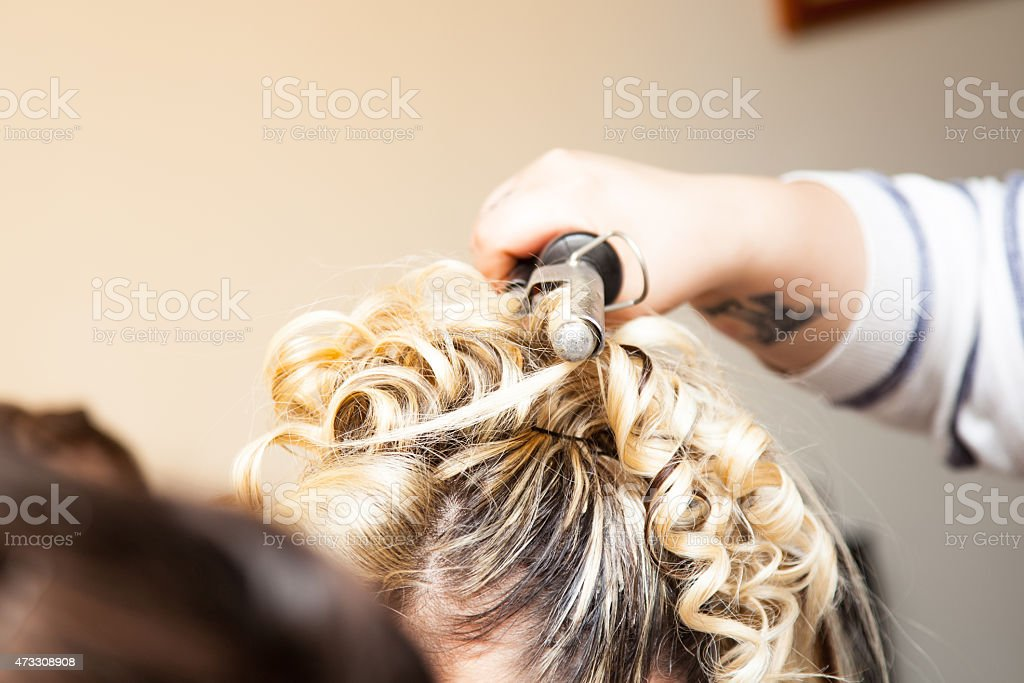 Electric hair curler stock photo