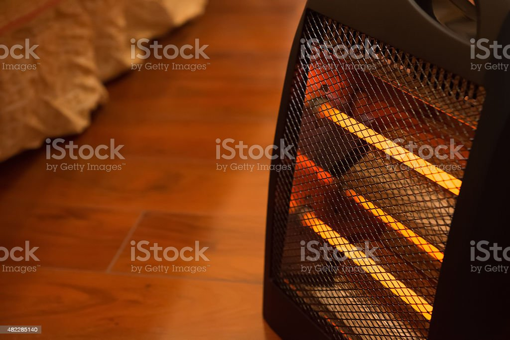electric heater in bed room stock photo