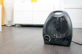 electric heater on laminate floor in the room