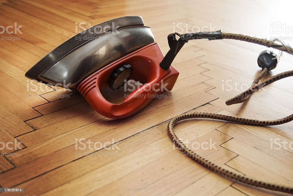 Electric iron on parquet stock photo