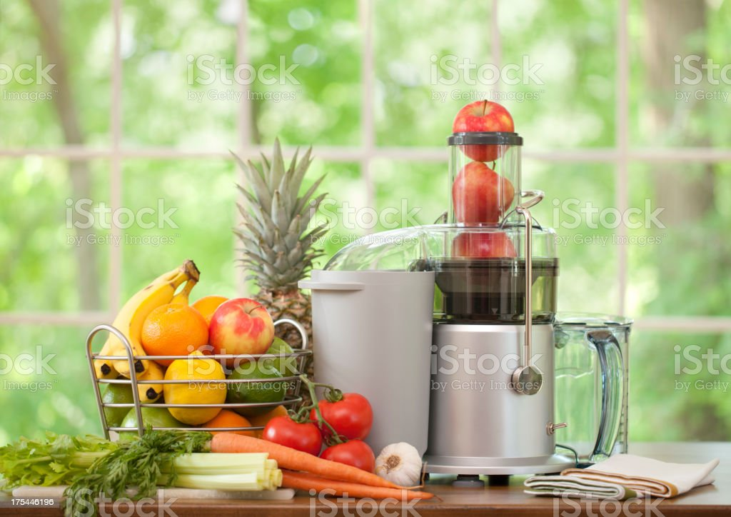 Electric Juice Machine with Fruit and Vegetables stock photo