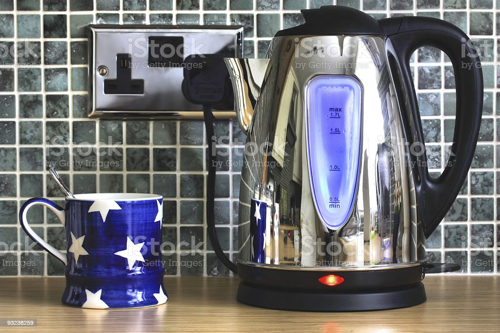 Electric kettle and cup stock photo