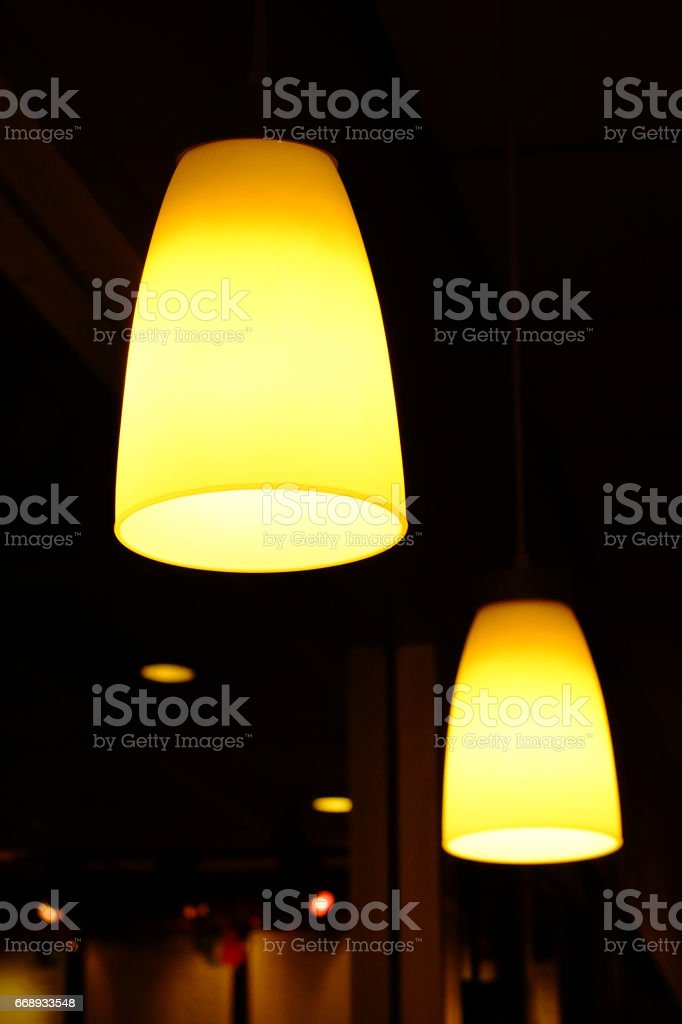 Electric lamp hanging from the ceiling on dark background stock photo