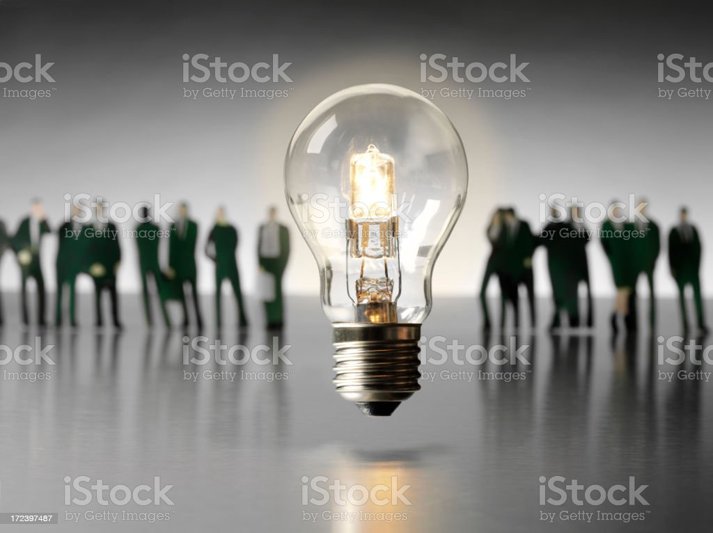 Electric Light Bulb with a Team of Business People royalty-free stock photo