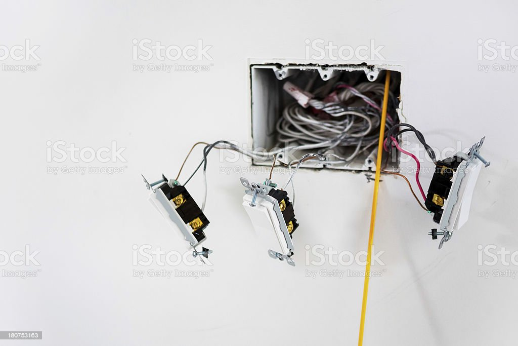 Electric light switches being installed royalty-free stock photo