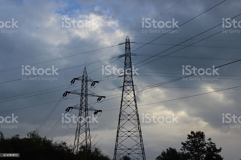 Electric lines in the sky stock photo