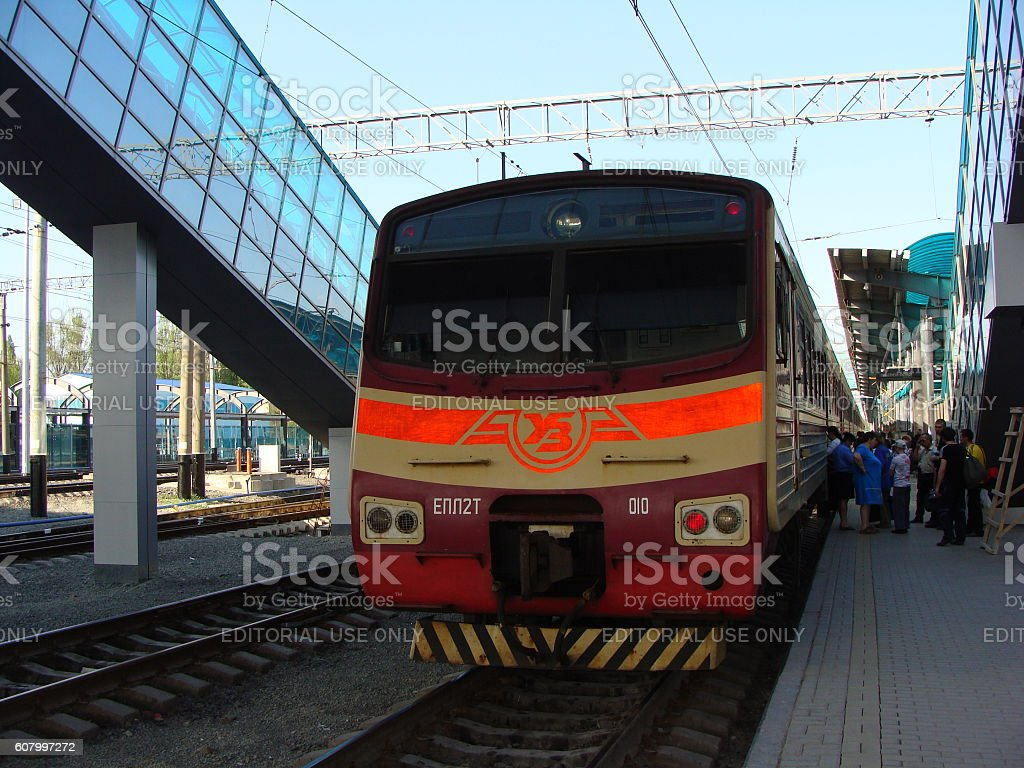 Electric Locomotive Arriving at a Modern Railway Station stock photo