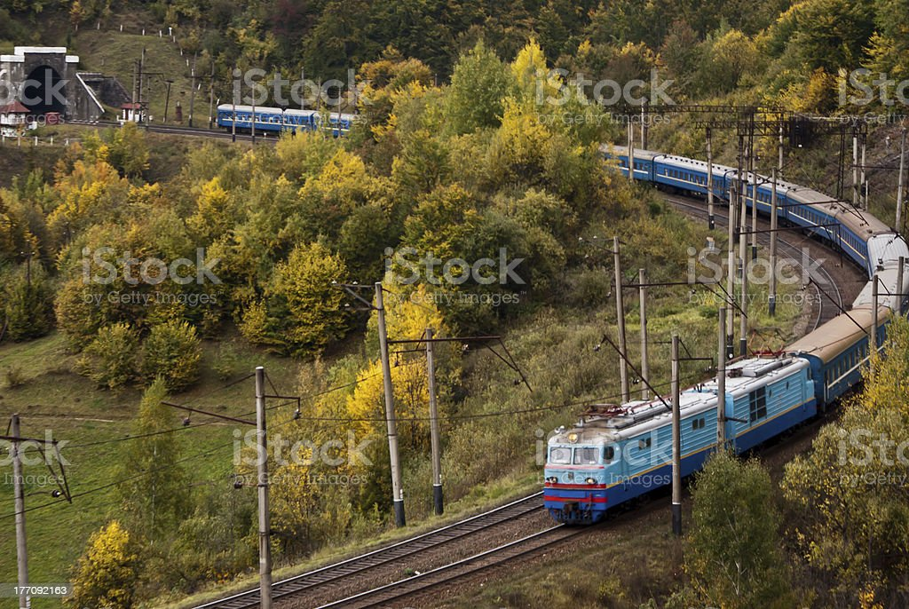 Electric locomotive with passenger cars royalty-free stock photo