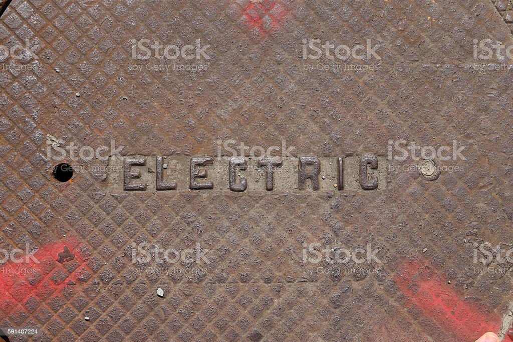 Electric manhole cover stock photo