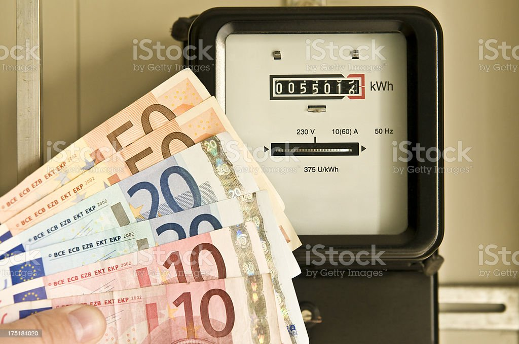 Electric meter and euro banknotes stock photo