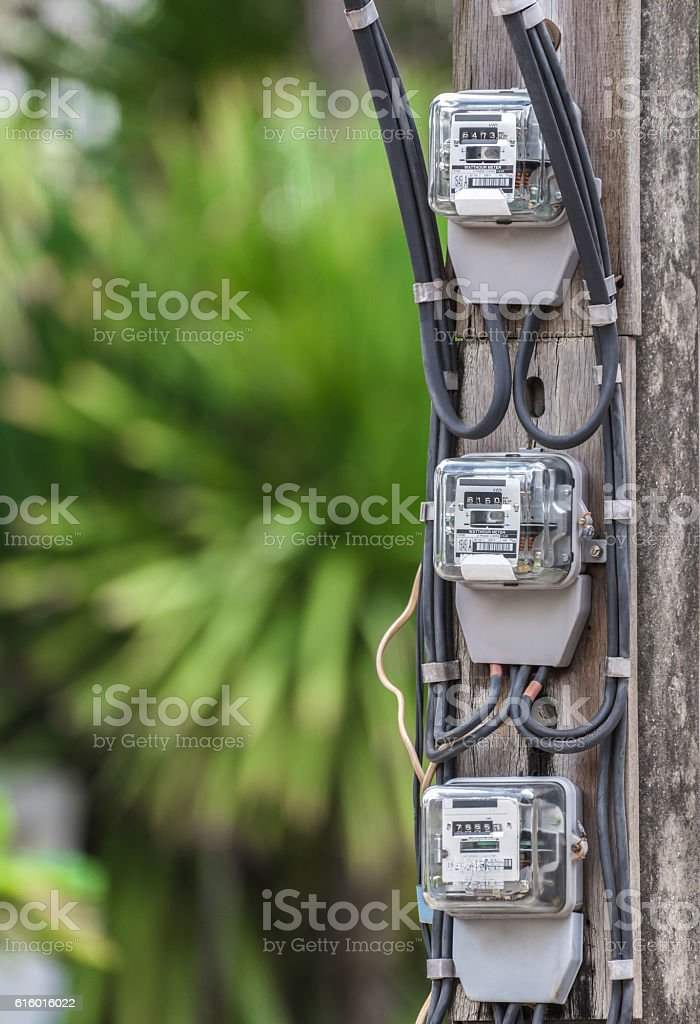 Electric meter measurement. outdoor on green background stock photo