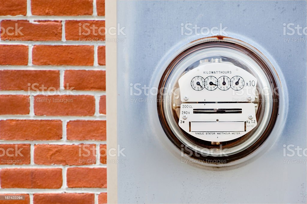 Electric meter on house stock photo
