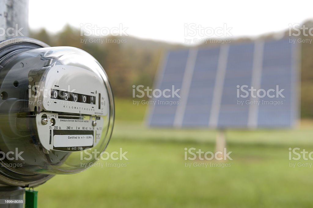 Electric meter with solar panel royalty-free stock photo