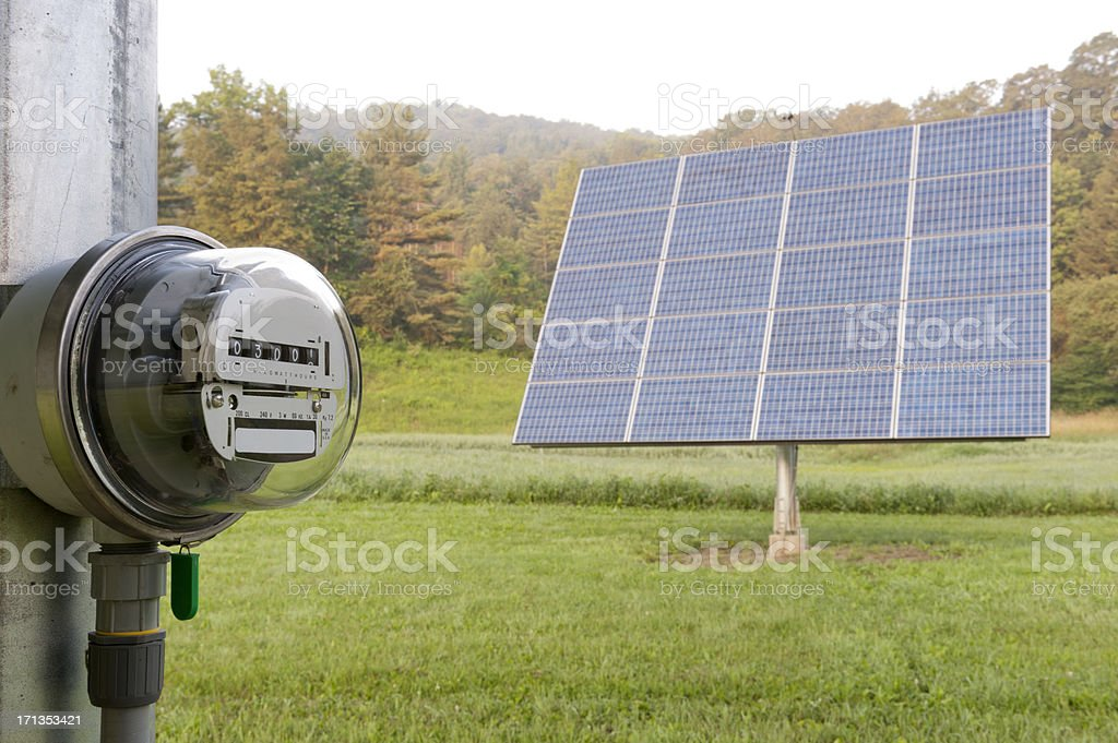 Electric meter with solar panel stock photo