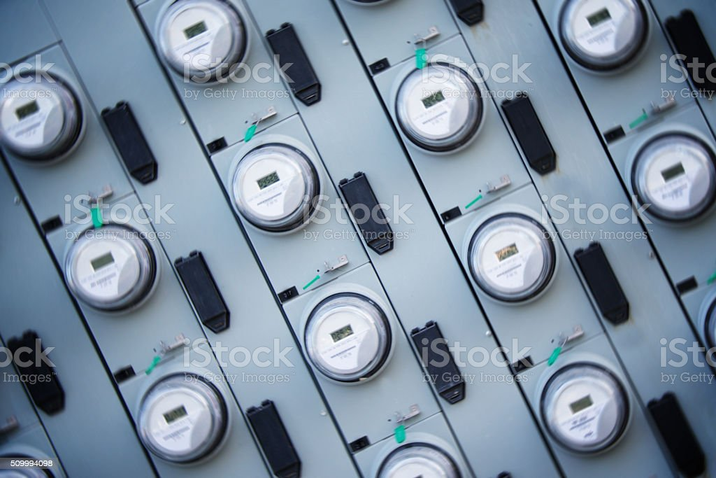 Electric Meters, Group of Apartment House Commerical Meters, Dutch Angle stock photo