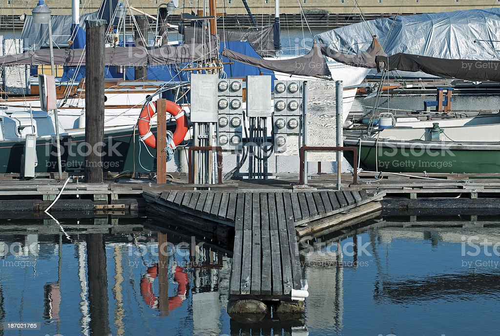 Electric meters on dock for live-aboards in Seattle marina stock photo