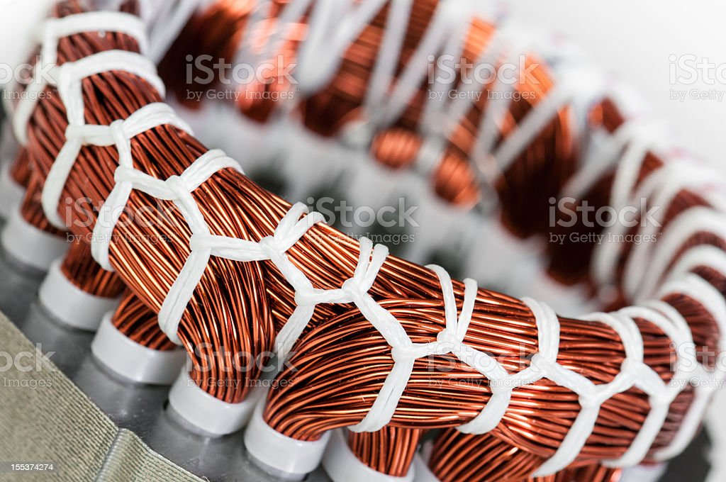 Electric motor stator winding and stack close-up stock photo