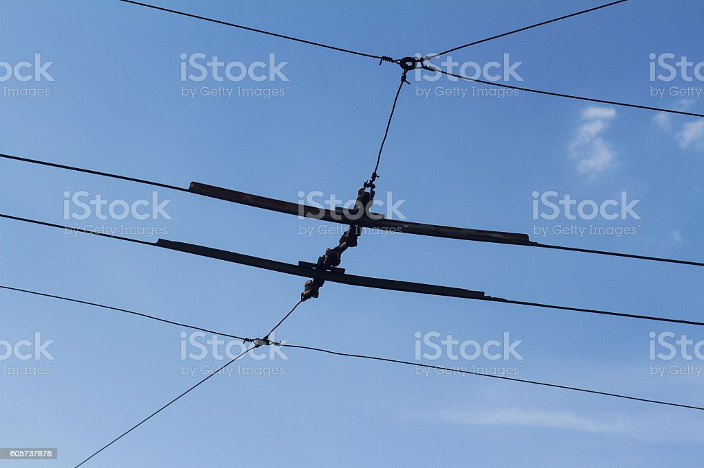 Electric outdoor lines of trolley bus stock photo