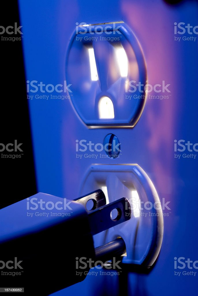 Electric outlet with glowing interior and plug royalty-free stock photo