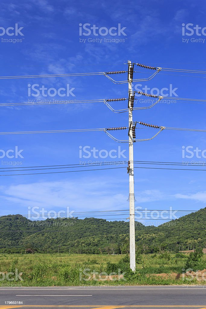 Electric pole on a blue sky background royalty-free stock photo