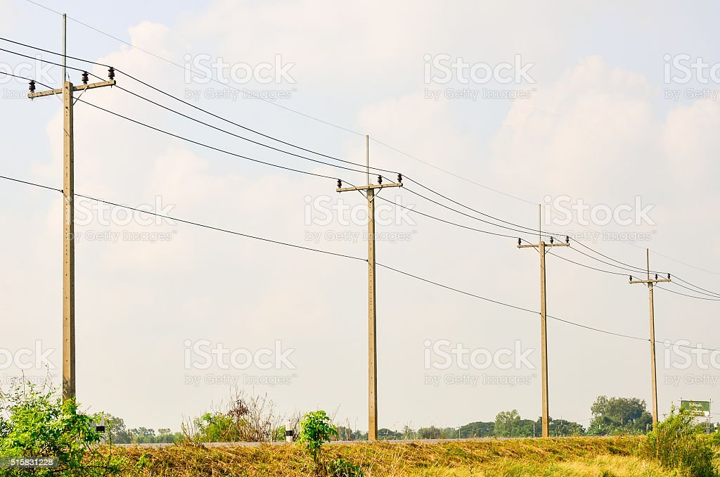 Electric pole on a country road stock photo