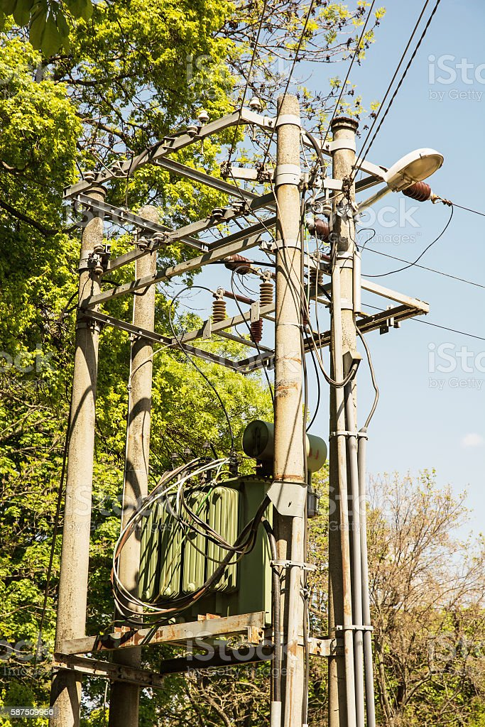 Electric pole with the transformer in the forest, power industry stock photo