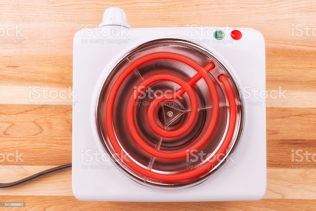 Electric portable stove on a heating element stock photo