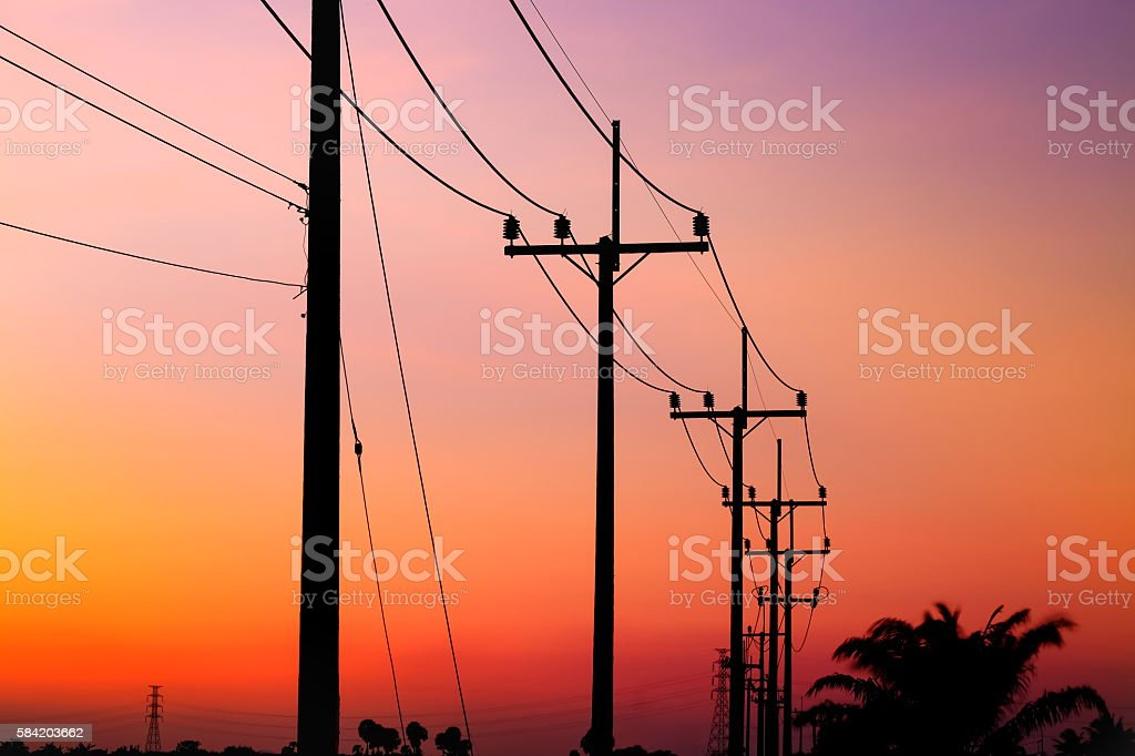 Electric post and sunset color of sky. stock photo