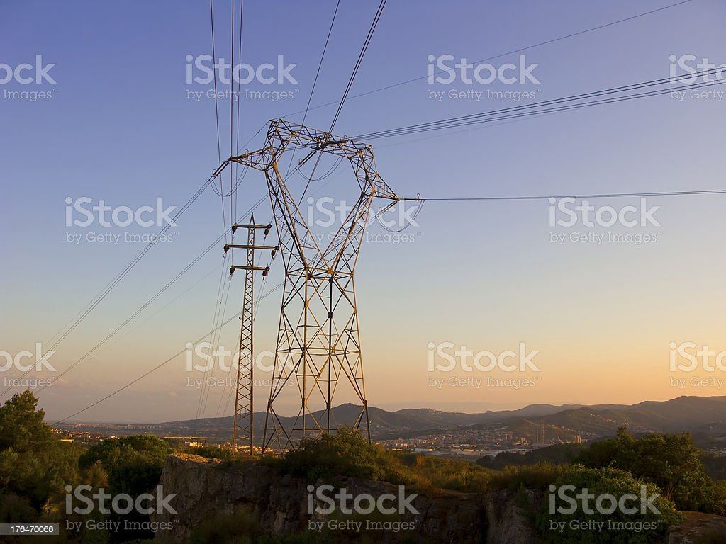 Electric posts at dusk royalty-free stock photo